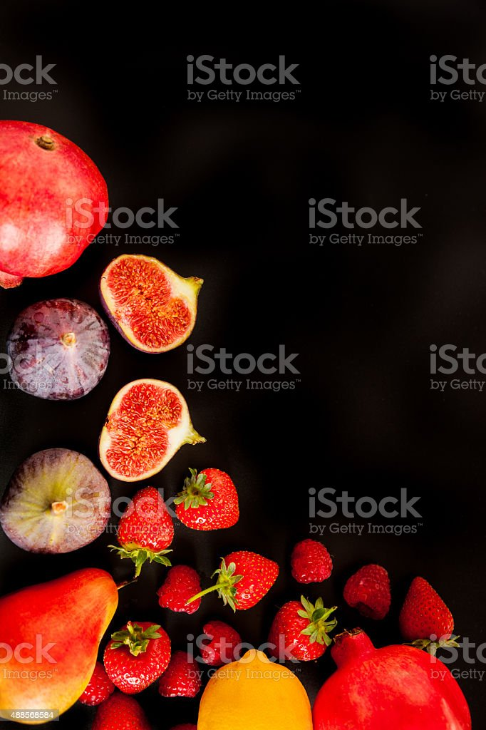 Variety of fruit on a blackground stock photo