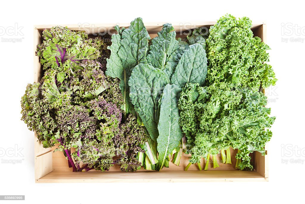 Variety of Green Kale in a Crate on White Background stock photo