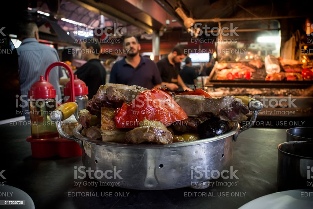 Variety of Grilled Meats Being Served stock photo