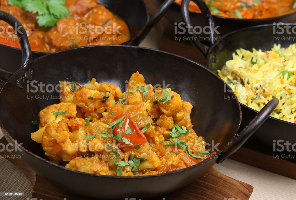 Variety of Indian foods including rice and vegetable curry  stock photo