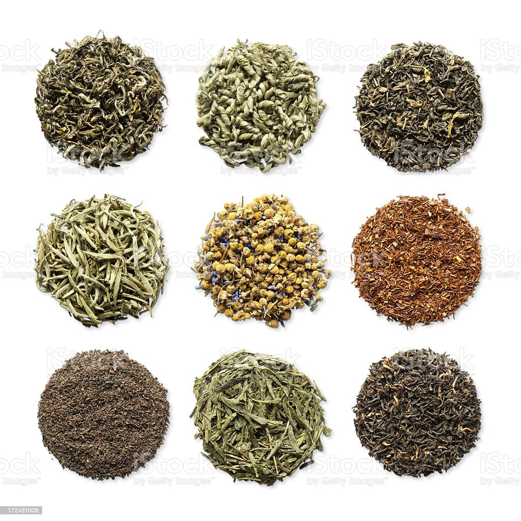 Variety of loose leaf herbal teas in round piles stock photo