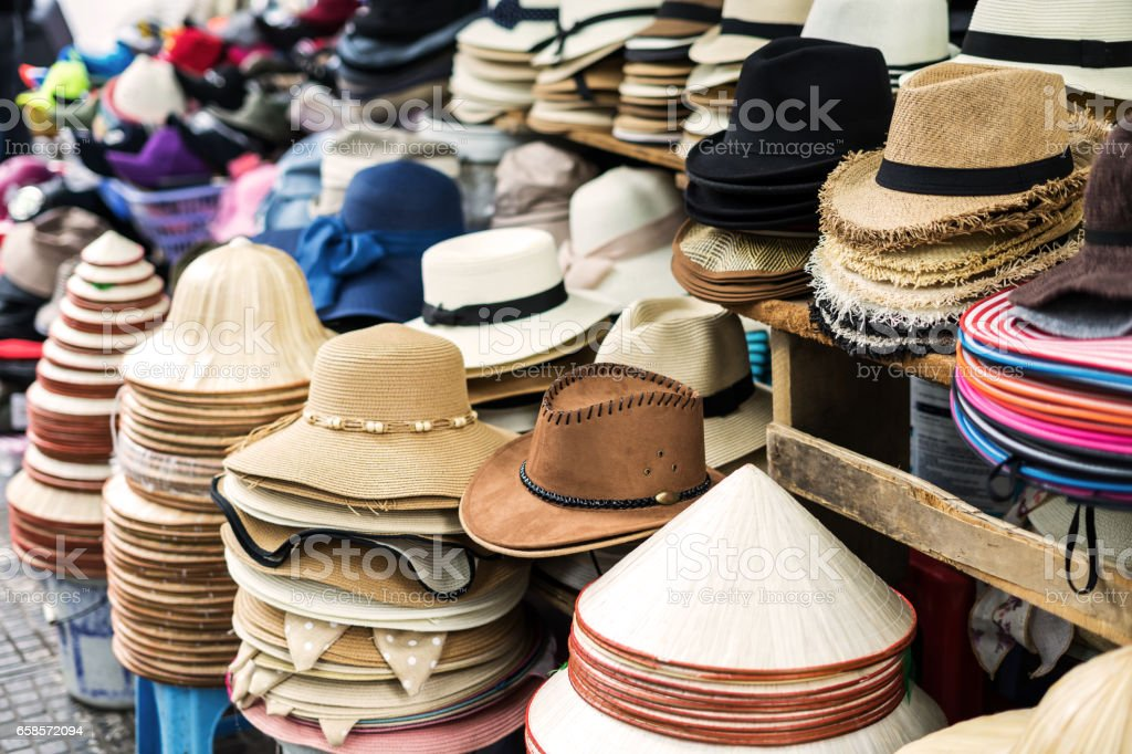 Variety of men and women hats at street market stock photo