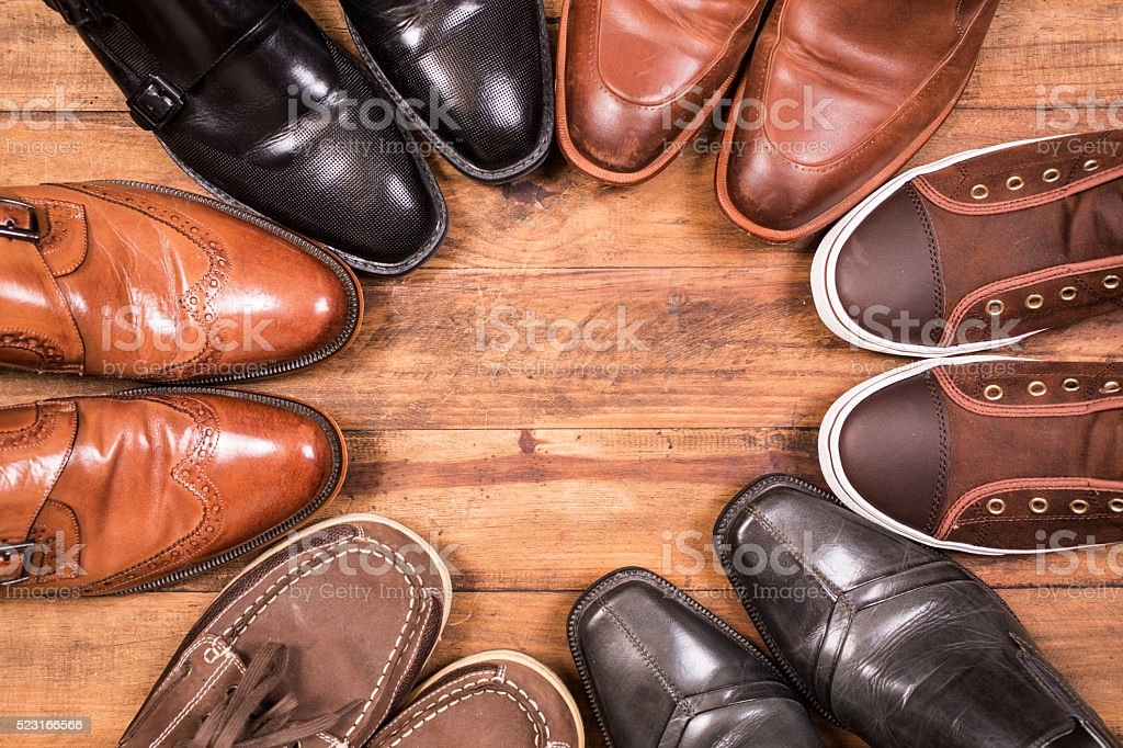 Variety of men's shoes in circle. Closet. No people. stock photo