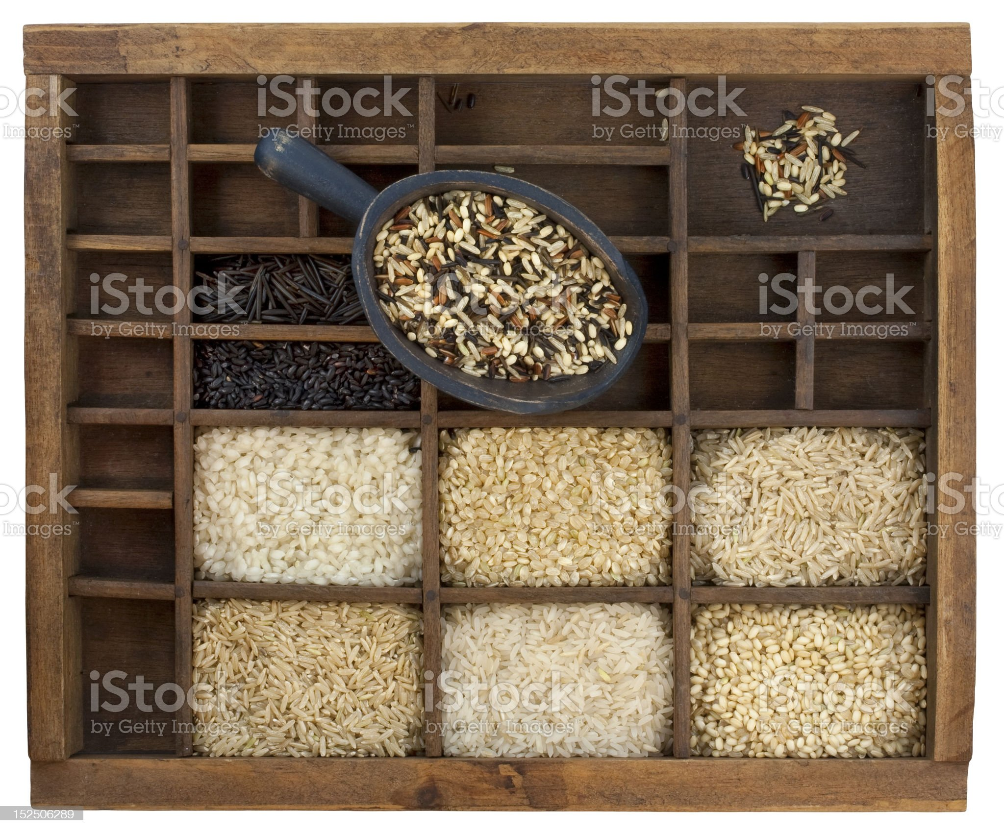 variety of rice grains in vintage wooden drawer with scoop royalty-free stock photo