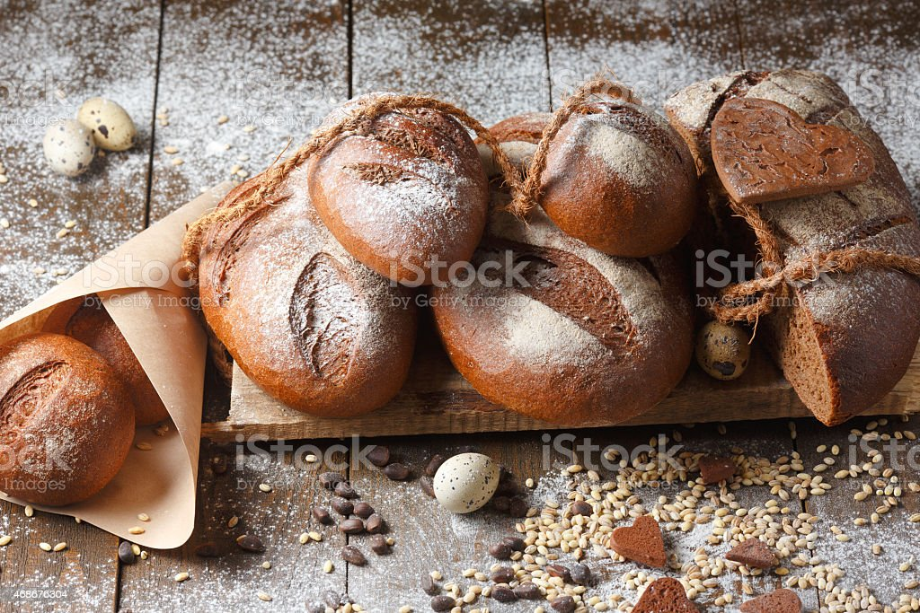 Variety of rye bread on a wooden background stock photo