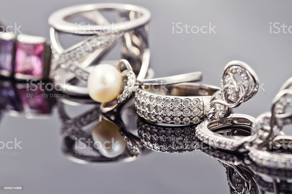 variety of silver jewelry stock photo