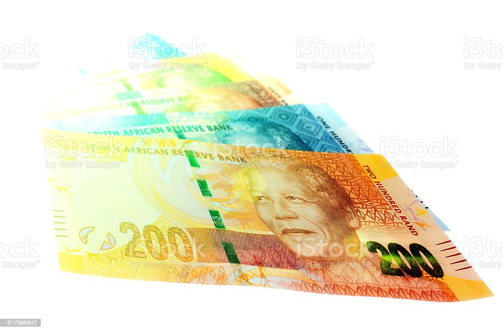 Variety of South African banknotes in bright light stock photo