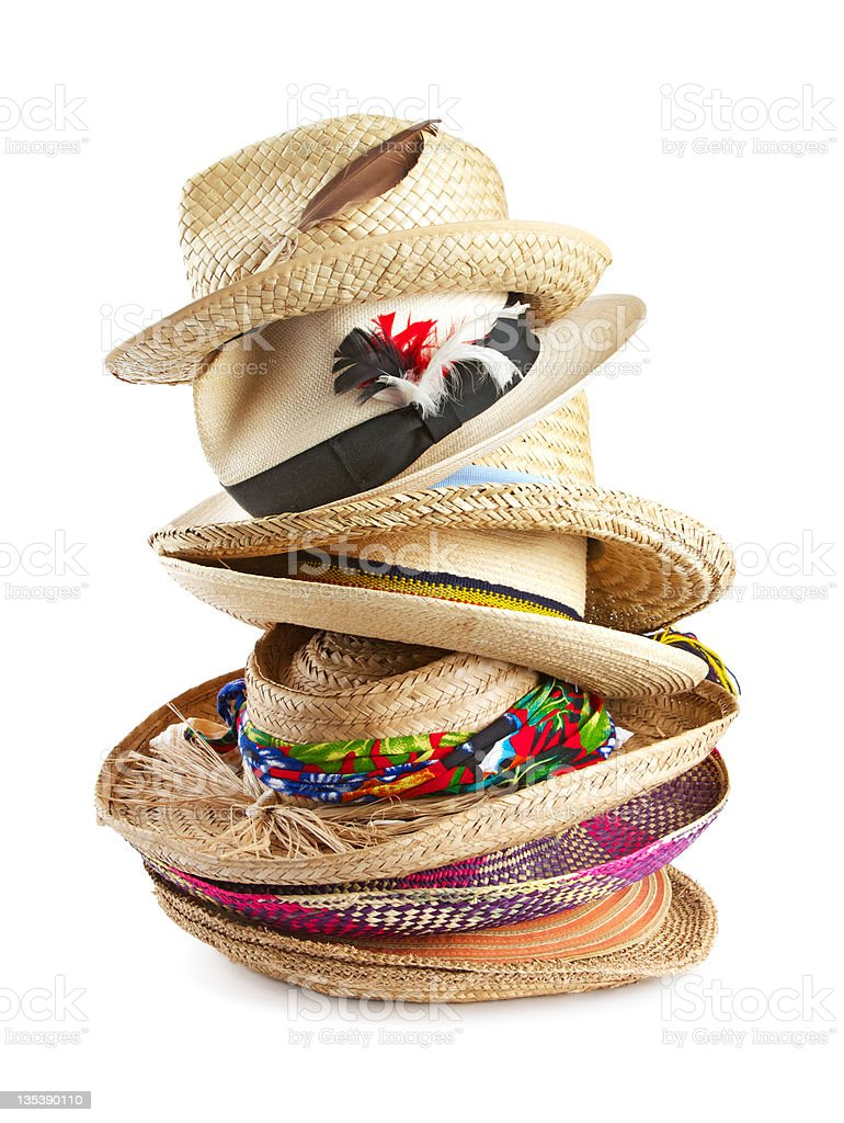 Variety of straw hats stacked vertically stock photo