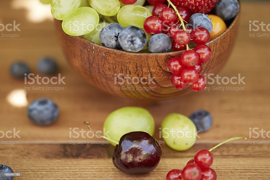 Variety of Summer Fruits in a wooden bowl royalty-free stock photo