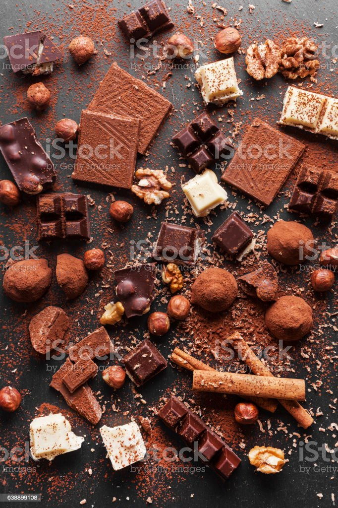 Variety of sweet homemade chocolate pralines on wooden background stock photo