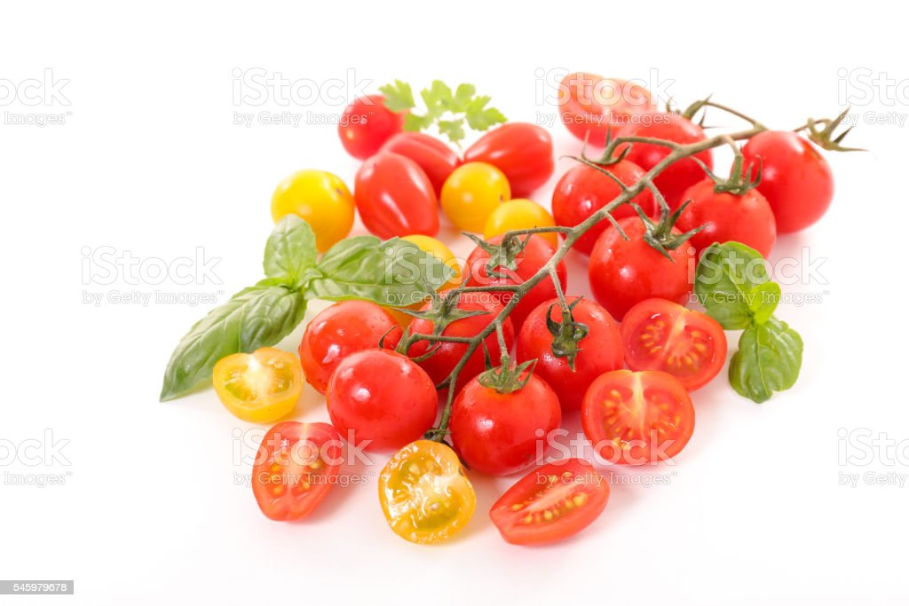 variety of tomatoes on white stock photo