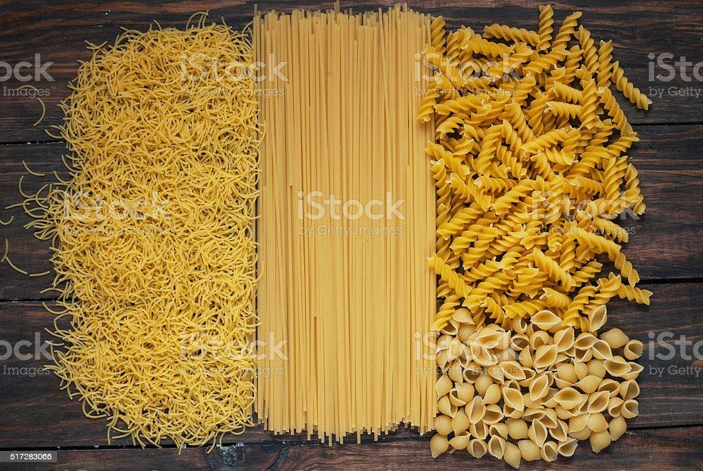 Variety of types and shapes Italian pasta stock photo