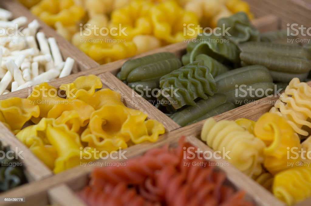 Variety of types, colors and shapes of Italian pasta. Dry pasta background stock photo