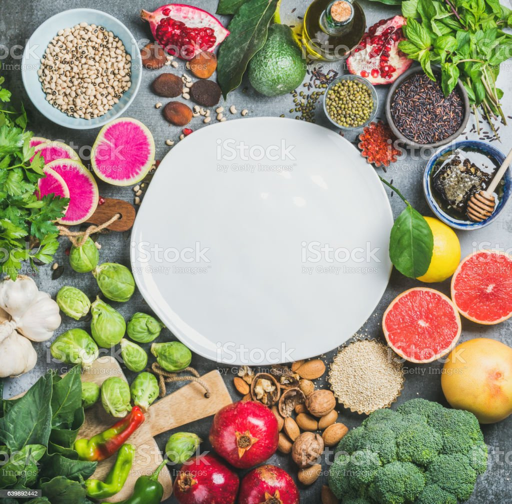 Variety of vegetables, fruit, seeds, cereals, beans, spices, superfoods, herbs stock photo