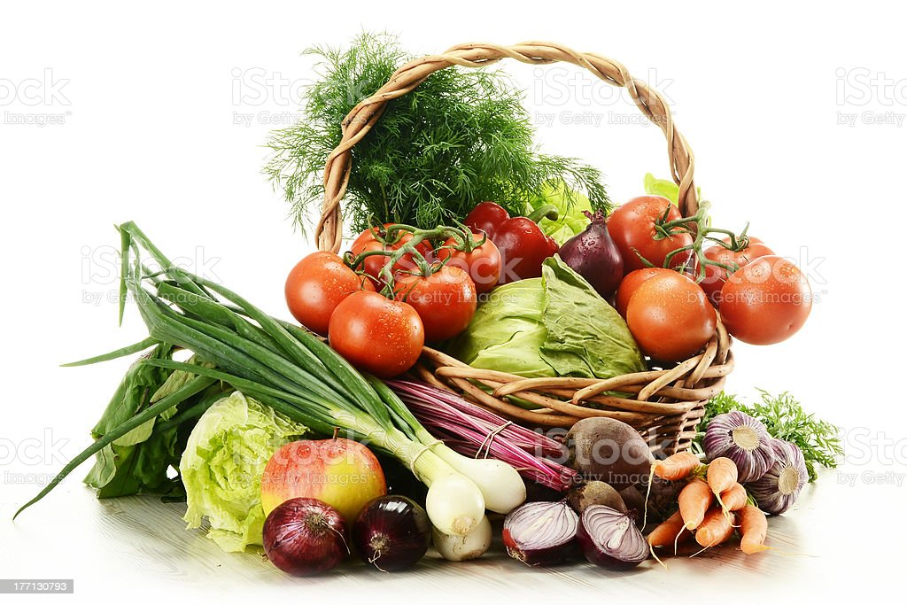 Variety of vegetables in wicker basket isolated on white royalty-free stock photo