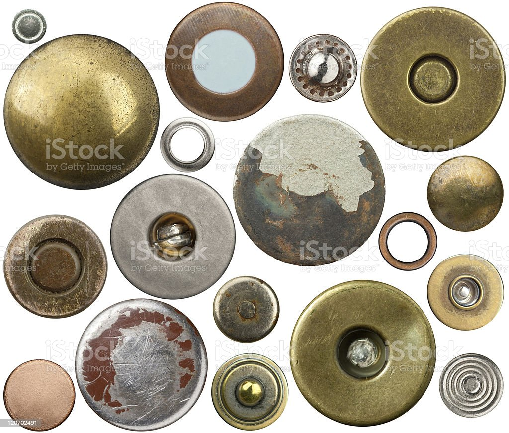 A variety of vintage Jean buttons on white background royalty-free stock photo