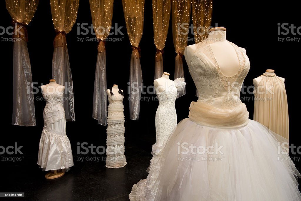 Variety of wedding dresses in a dark room royalty-free stock photo