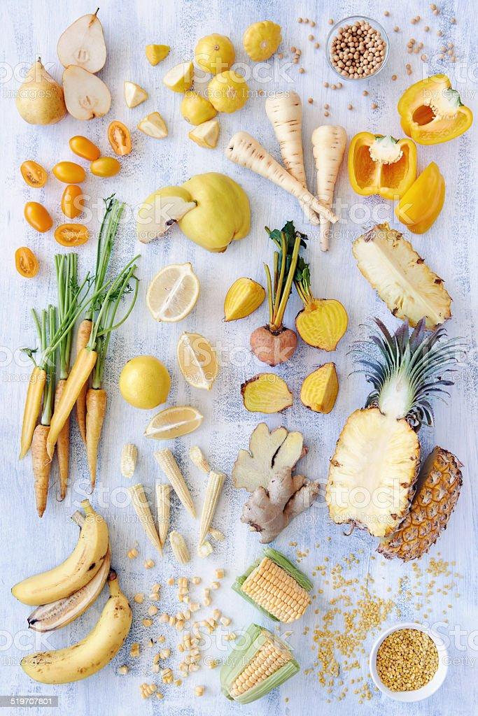 Variety of yellow toned fresh produce stock photo