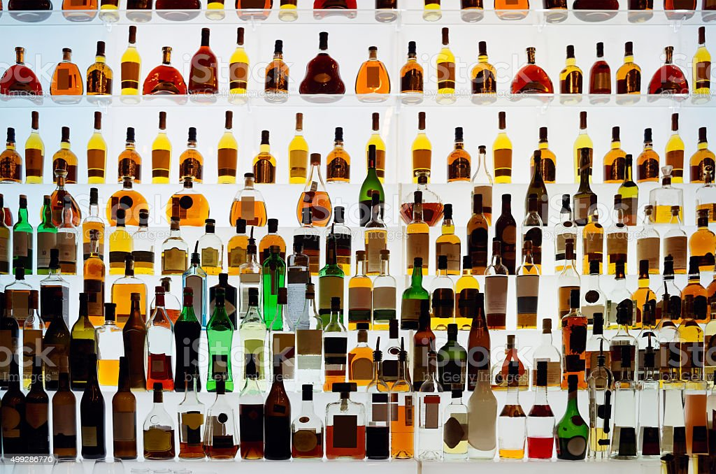 Various alcohol bottles in a bar stock photo