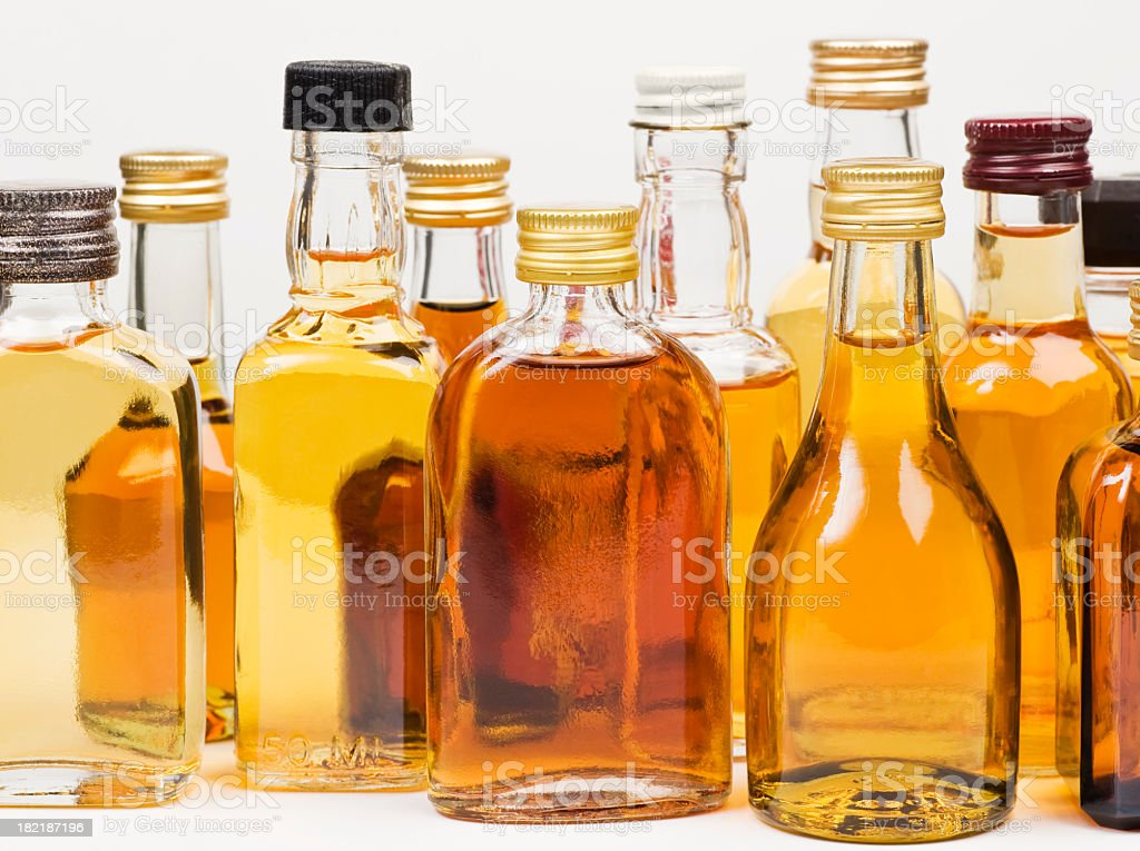 Various alcohol bottles on white stock photo