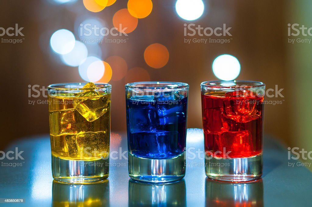 Various alcoholic cocktails on a bar counter with magic light stock photo