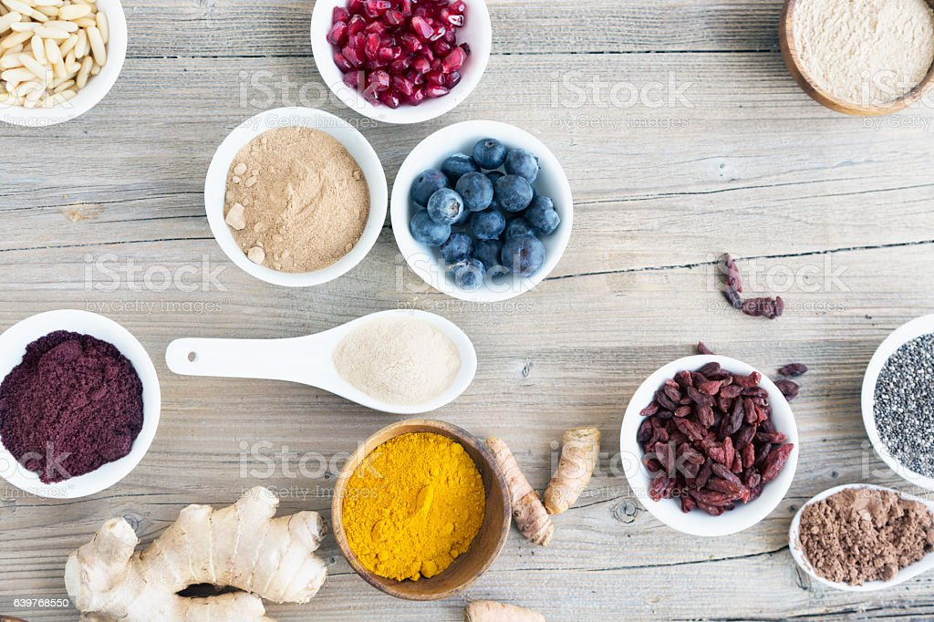 various antioxidant superfoods in  bowls stock photo