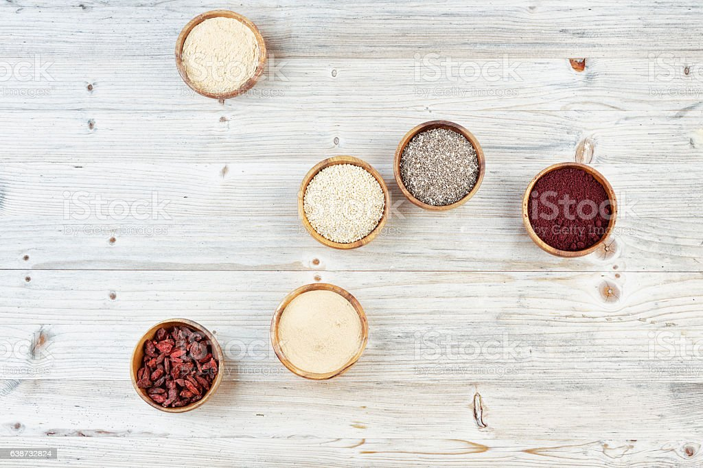 various antioxidant superfoods in wooden bowls stock photo