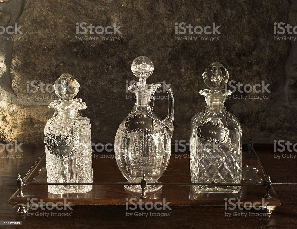 Various Antique Glass Decanters On Wooden Tray royalty-free stock photo