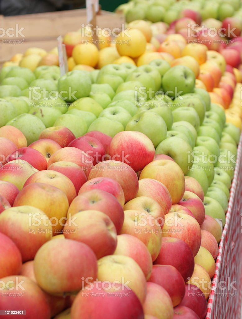 various apples in a market place.center focus stock photo