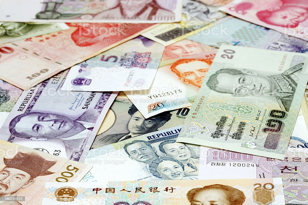 Various Asian bank currencies in a pile stock photo