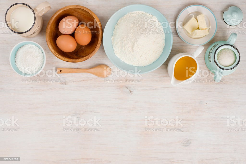 Various bakery ingredients on wood textured table, view from above stock photo