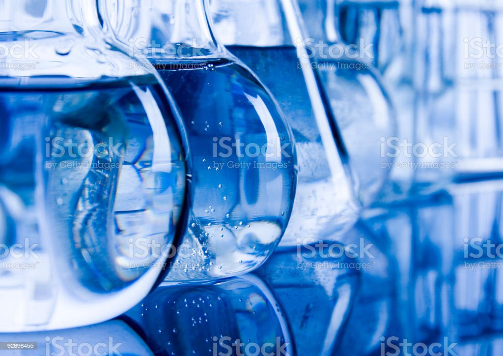 Various beakers with liquid in the on a table stock photo