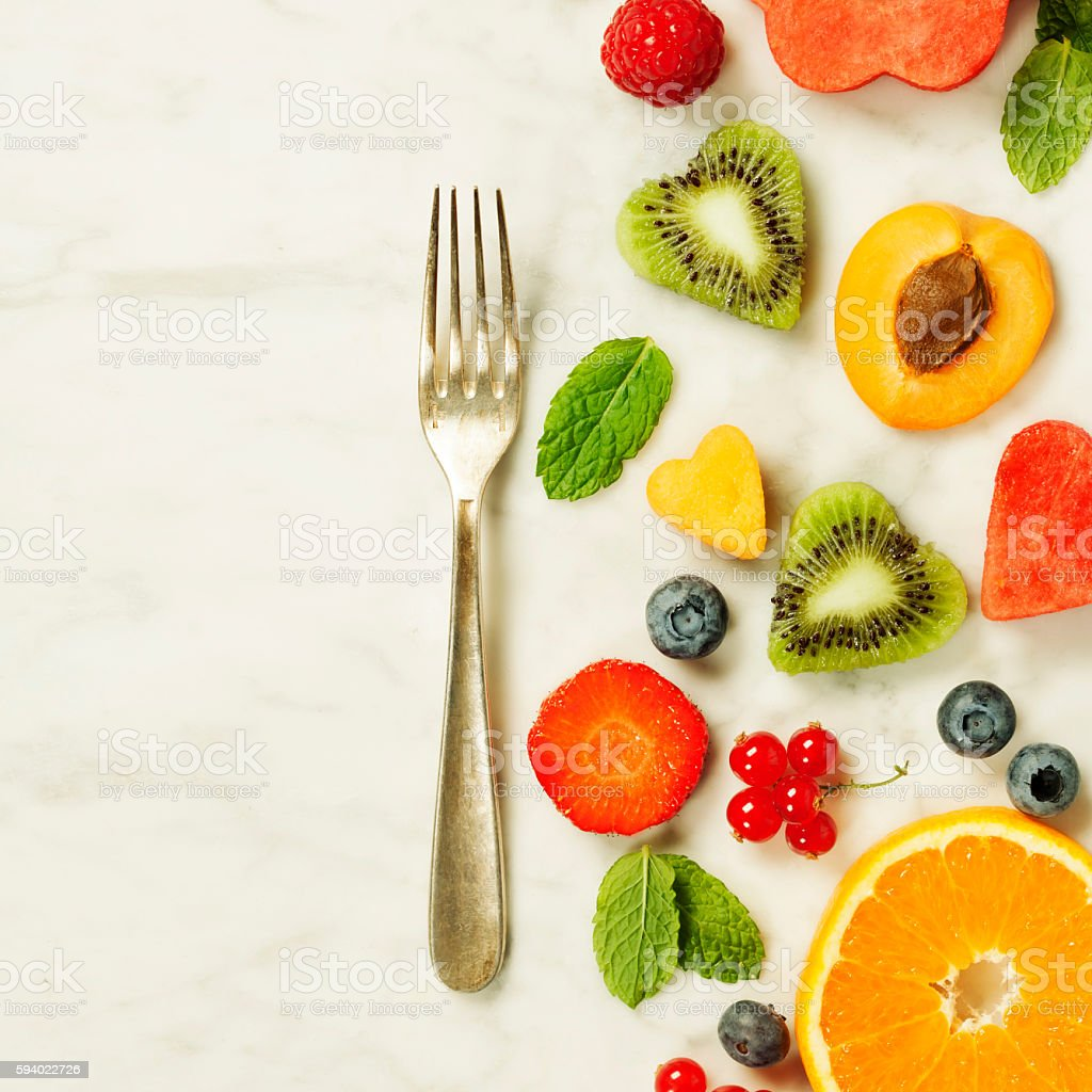Various berries and fruits stock photo