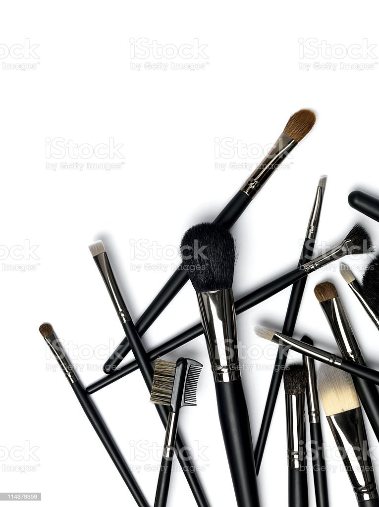 Various black make up brushes on a white background stock photo