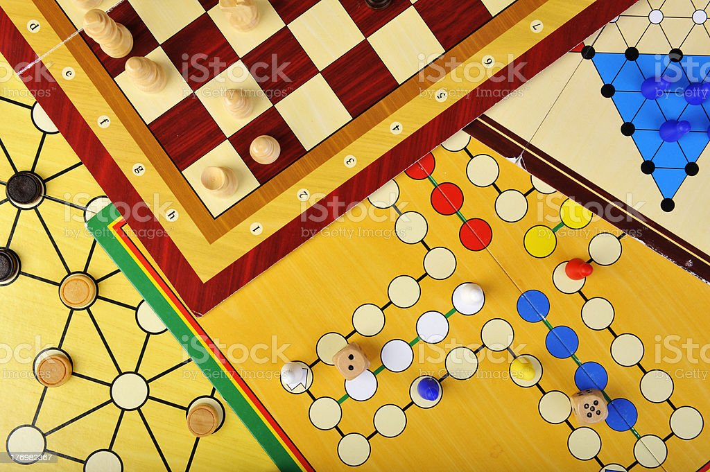 Various board games layered on top of each other stock photo