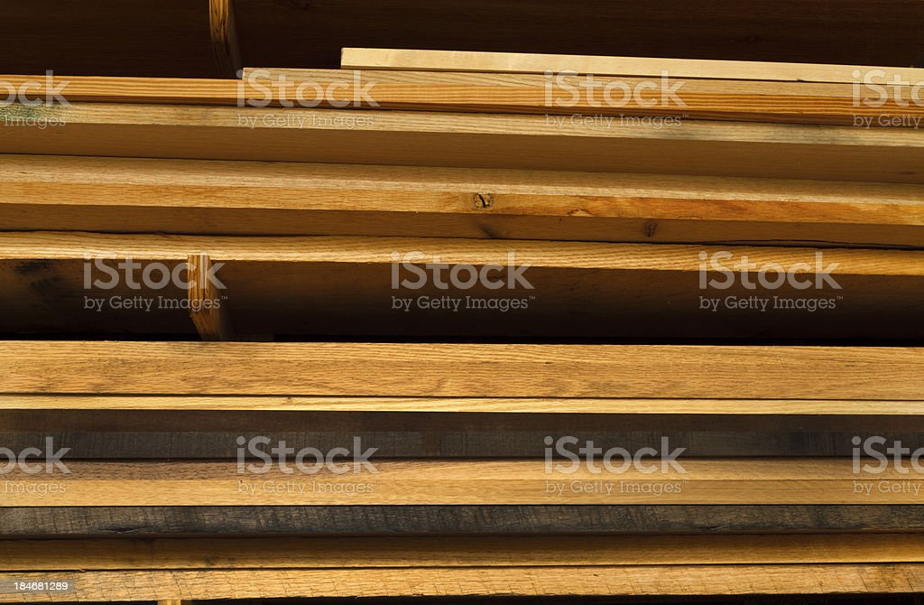 Various Boards of Lumber Stacked In A Workshop royalty-free stock photo