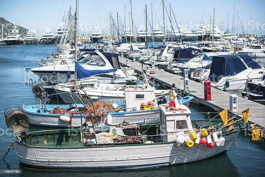 Various boats at rest in the marina royalty-free stock photo