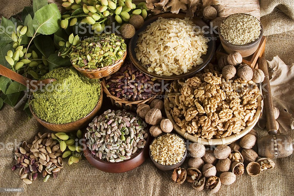 Various bowls full of assortment of different nuts stock photo