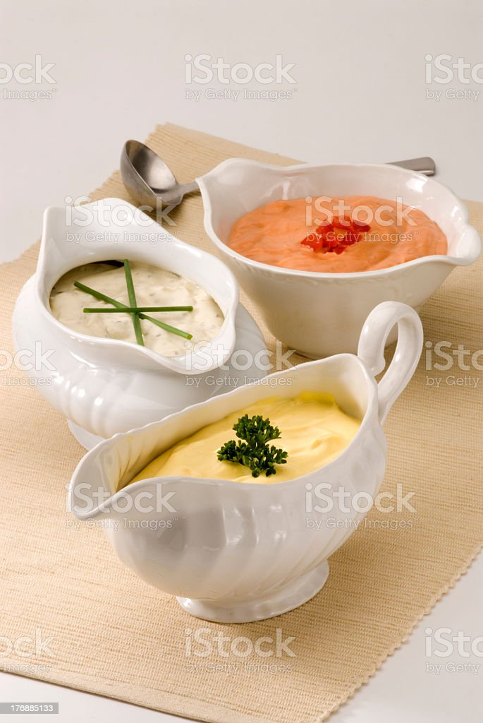 Various bowls of assorted sauces stock photo