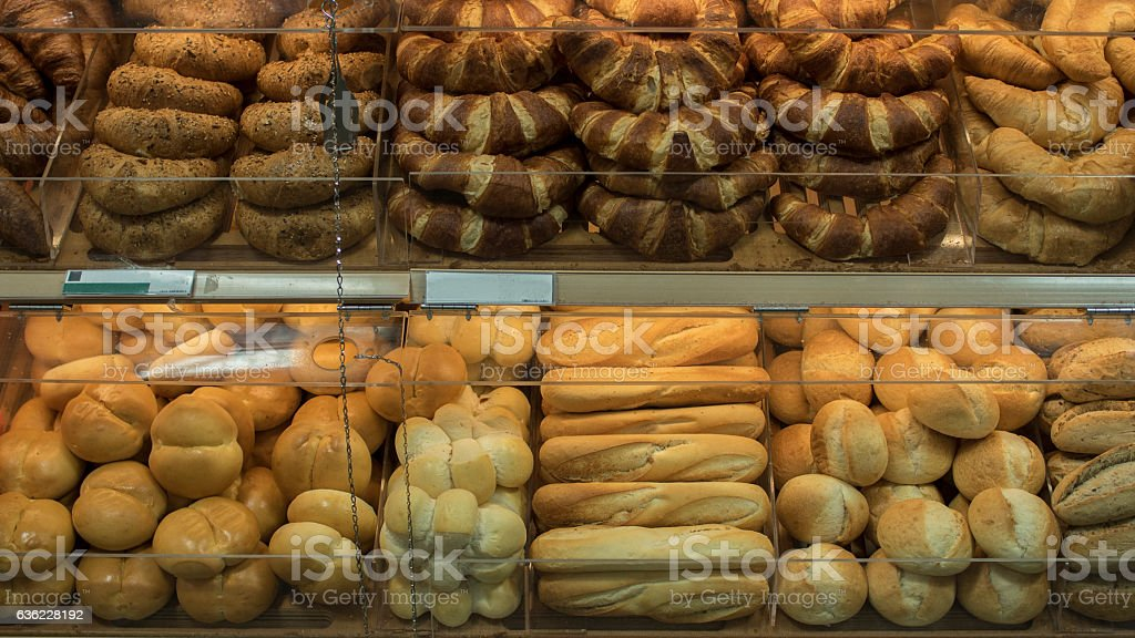 Various bread on shelf of bakery shop stock photo