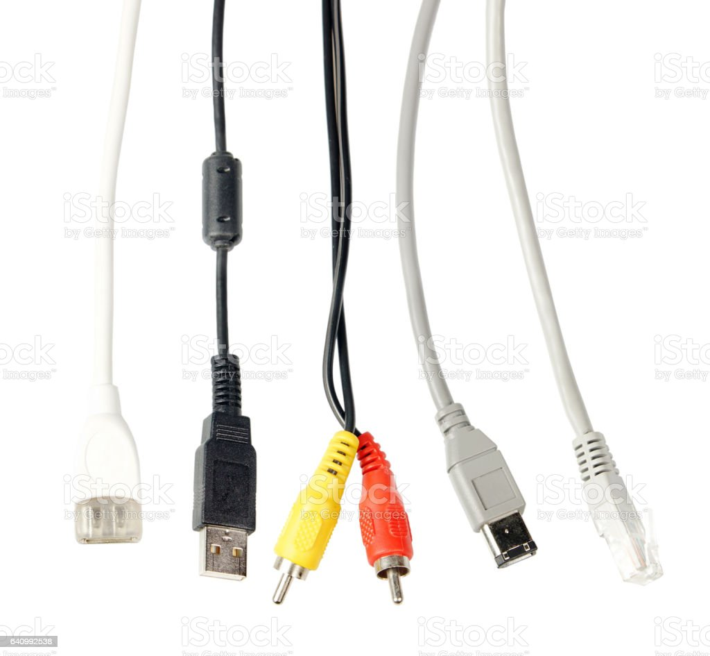 Various cables for devices isolated over white background stock photo