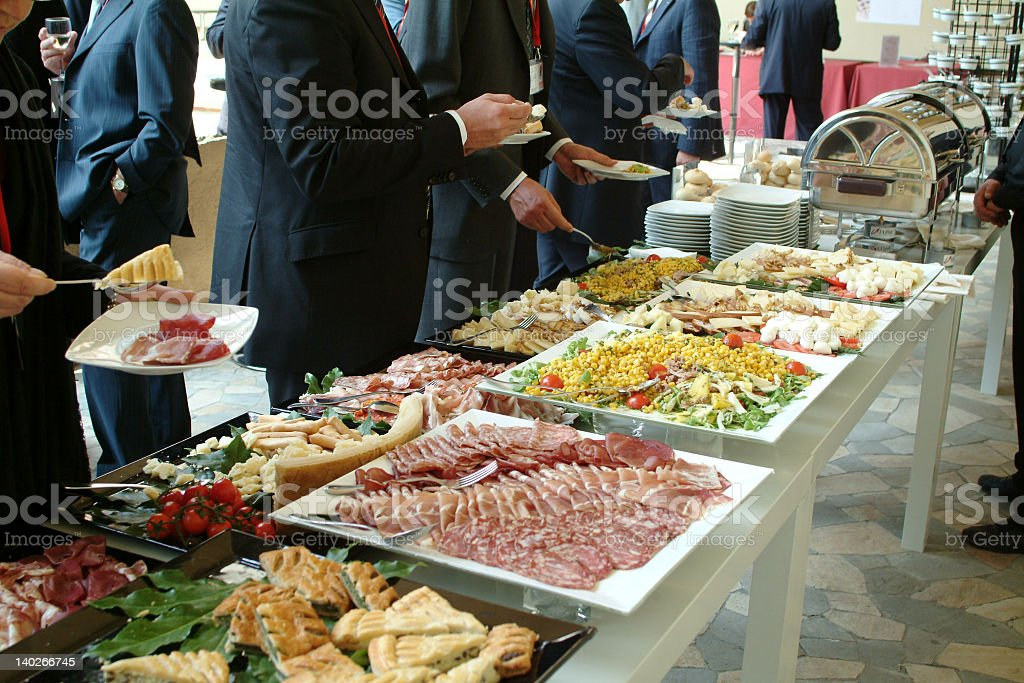Various catered platters on the table stock photo