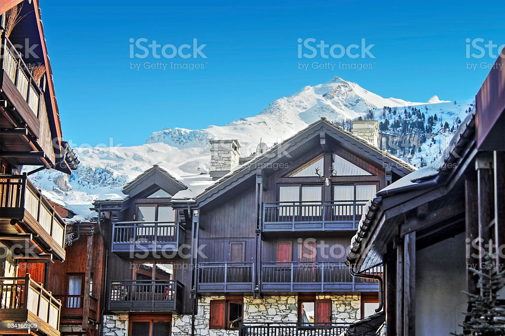 Various chalet in ski resort of Alps mountains stock photo