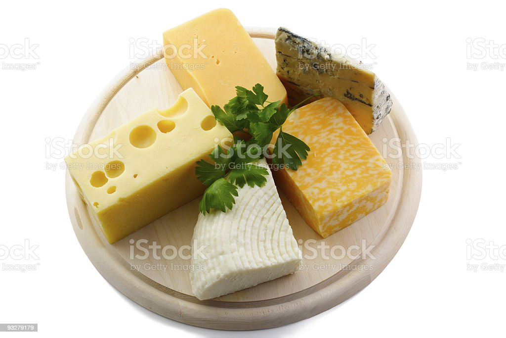 Various cheeses on catting board royalty-free stock photo