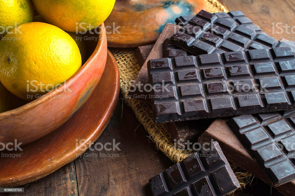 Various chocolate on wood and oranges stock photo