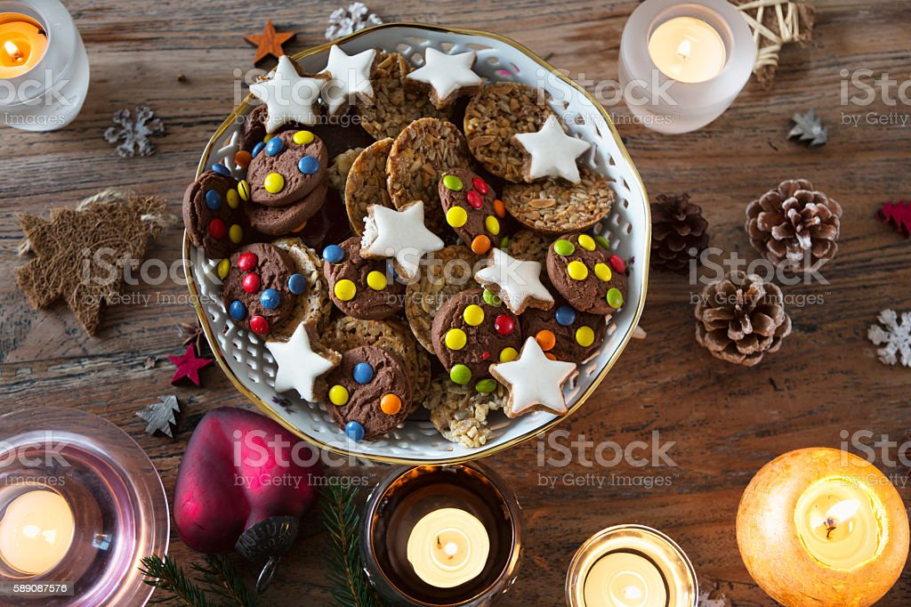 various christmas cookies on wooden table stock photo