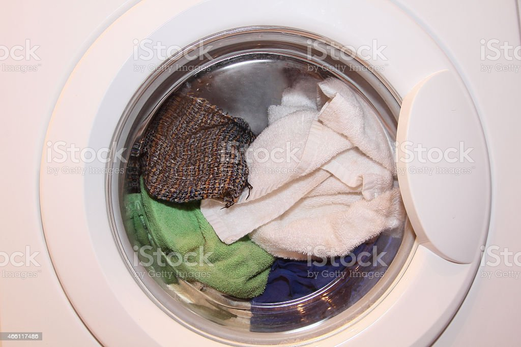 Various clothes in washing machine. stock photo