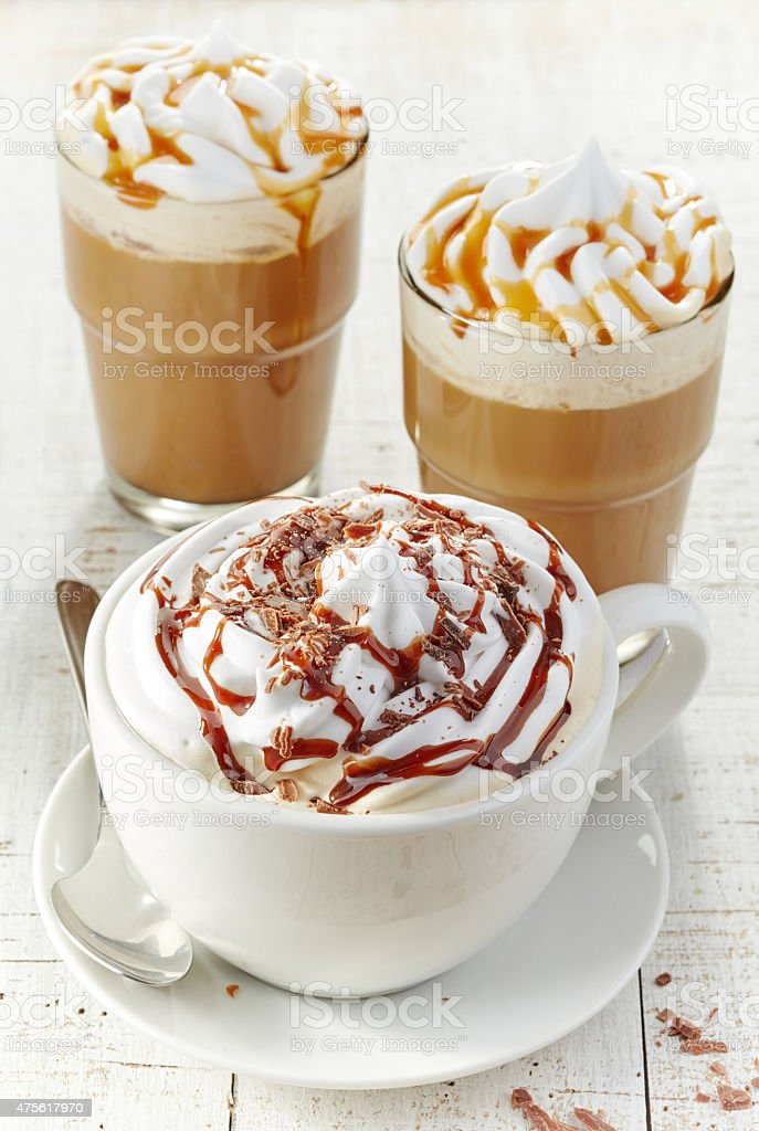 various coffee cups with whipped cream stock photo