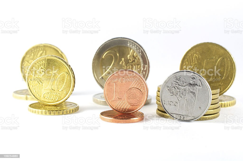 various coins euro compared with the lira coin royalty-free stock photo