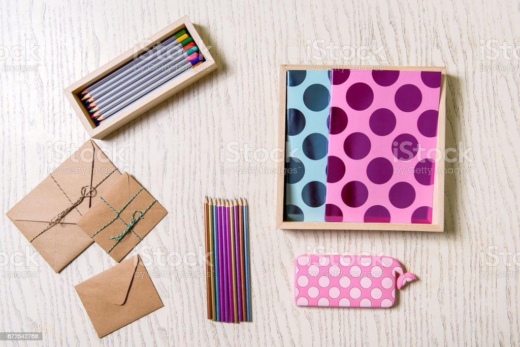 Various colored pencils near envelopes stock photo